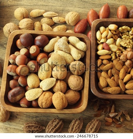 Varieties of nuts: peanuts, almonds, chestnuts, walnuts,  pistachio and pecans. Food and cuisine. - stock photo