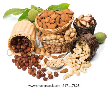 Varieties of nuts: peanuts, hazelnuts, cashew, walnuts, pistachio, brazil and  pine nuts isolated on white background  - stock photo