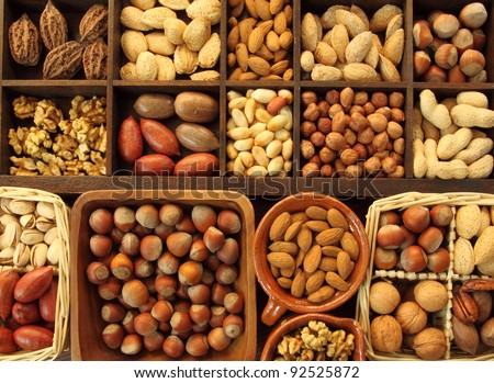 Varieties of nuts: peanuts, hazelnuts, chestnuts, walnuts,  pistachio and others. - stock photo