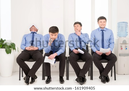 Varieties of poses man waiting for job interview. Sitting in office  - stock photo