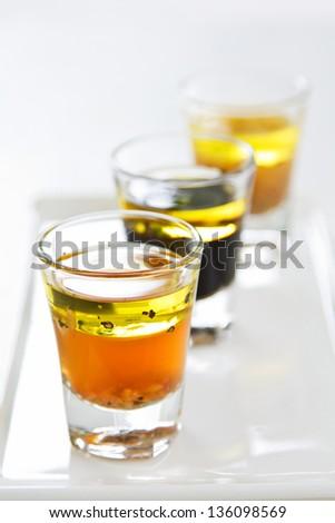 Varieties of salad dressing in glasses shot - stock photo