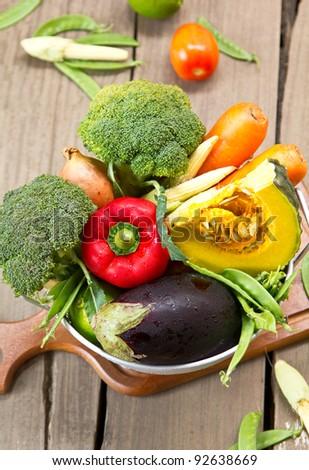 Varieties of vegetable in colander - stock photo