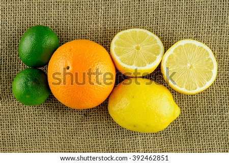 Variety lemon, lime and orange of citrus fruits - stock photo
