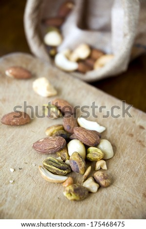 variety nuts on wooden board
