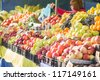 Variety of apples, oranges and grapes in boxes on city market - stock photo