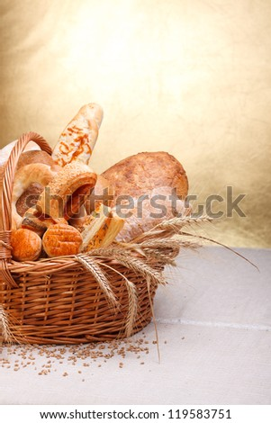 Variety of baked products in basket. - stock photo