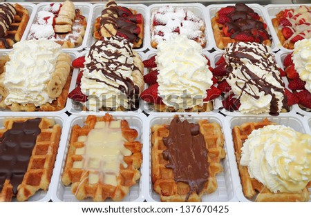 Variety of Belgian waffles on street stall in Brussels, Belgium, Europe - stock photo