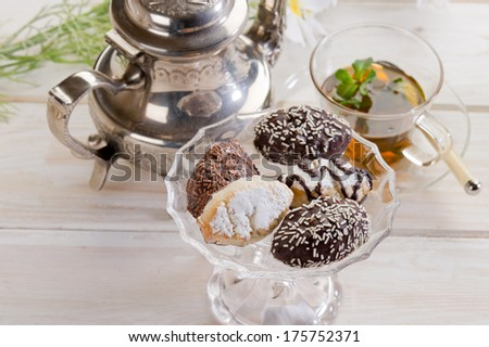 variety of biscuit over  bowl  and tea