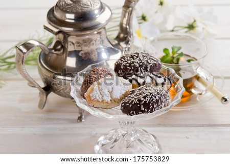 variety of biscuit over  bowl  and tea - stock photo
