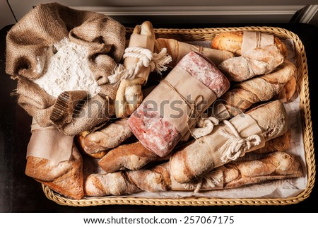 variety of bread, ciabatta, grissini, malted and beet bread - stock photo