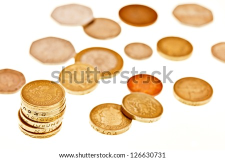 Variety of british coins spread out on white background - stock photo