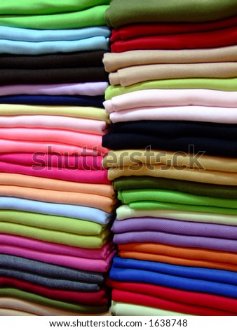 Variety of cashmere scarves in a pile