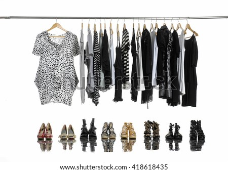 Variety of casual female clothing on hangers and shoes,boots