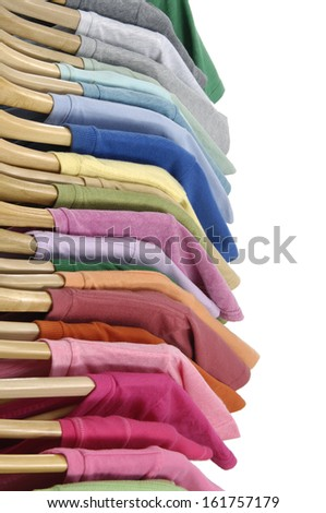 Variety of casual shirts on wooden hangers