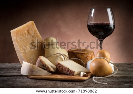 variety of cheese and red wine - stock photo