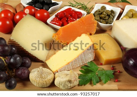 Variety of cheese: gouda, ementaler, mimolette and other . Herbs and spices.