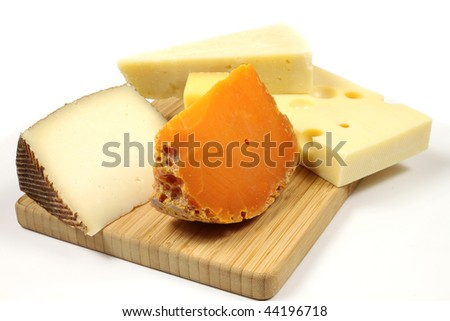 Variety of cheese: parmesan, mimolette, gouda and other hard cheese - stock photo