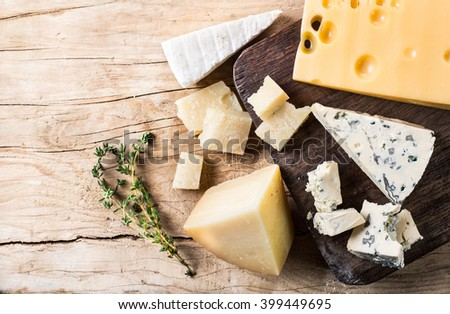 Variety of cheeses on a wooden board