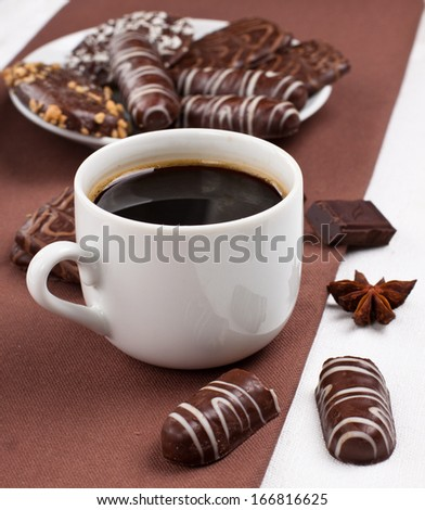 Variety of chocolate biscuits with cup of coffee