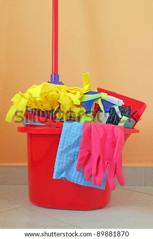 variety of cleaning products in bucket - stock photo
