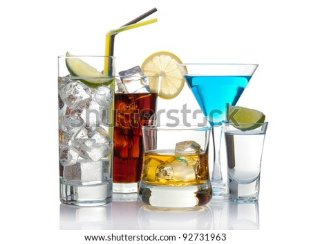 Variety of cocktails isolated on white with reflection - stock photo