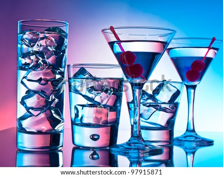 Variety of cocktails on pink and blue background - stock photo