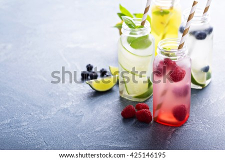 Variety of cold drinks in small bottles - stock photo