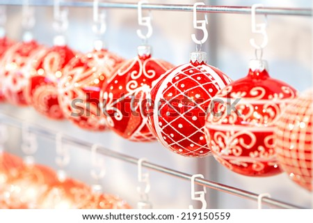 Variety of color balls for christmas decorations hanging in supermarket - stock photo
