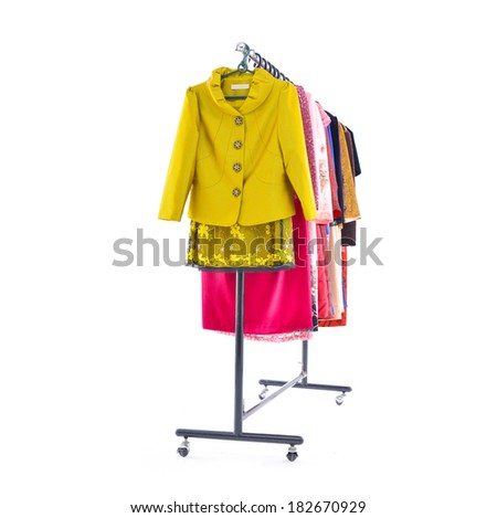 Variety of colorful fashion clothing on hanging-white background - stock photo