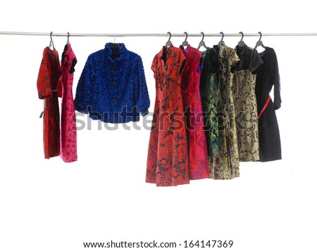 Variety of colorful female clothing and sundress on hanging