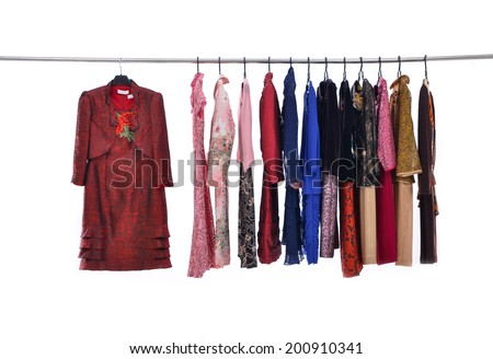 Variety of colorful female clothing on hanging-white background