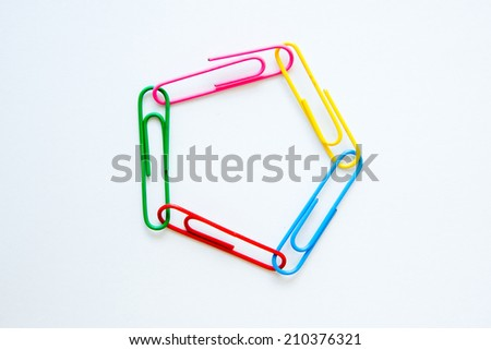 variety of colorful paper clips on white background : synergy and relations concept - stock photo