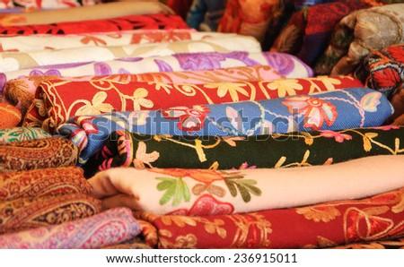 Variety of colorful shawls at street bazaar. - stock photo
