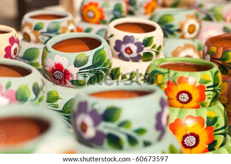 Variety of Colorfully Painted Ceramic Pots in an Outdoor Shopping Market. - stock photo