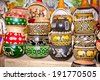 Variety of colorfully painted wooden flowers pots in market, Nairobi, Africa. - stock photo