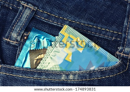 variety of Condoms in the blue jeans pocket - stock photo