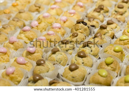 variety of decorated sweet pastry cream puffs