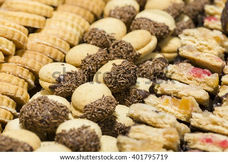 variety of decorated sweet pastry with chocolate - stock photo