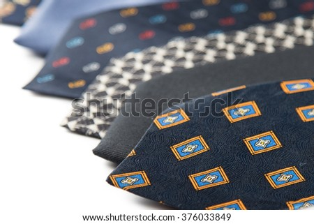variety of elegant colorful male ties on white
