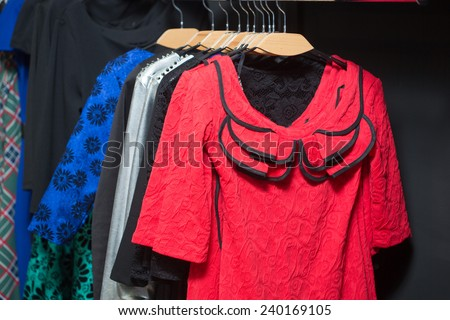 Variety of female colorful clothes - stock photo