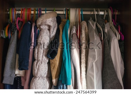 Variety of female colorful clothes on Hangers - stock photo