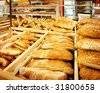 Variety of fresh bread in a supermarket - stock photo