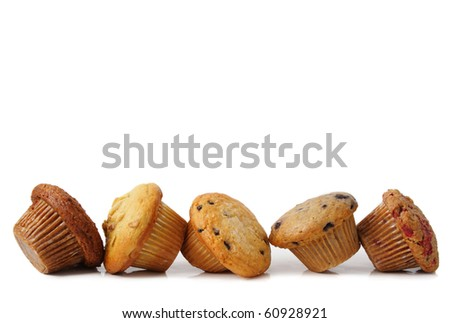 variety of fresh muffins cupcake isolated on white