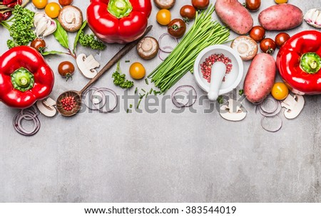 Variety of fresh organic vegetables and seasoning for tasty vegetarian cooking with mortar, pestle and wooden spoon on gray concrete texture background, top view, banner. Healthy lifestyle concept. - stock photo