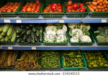 Variety of fresh vegetables on display in grocery store - stock photo