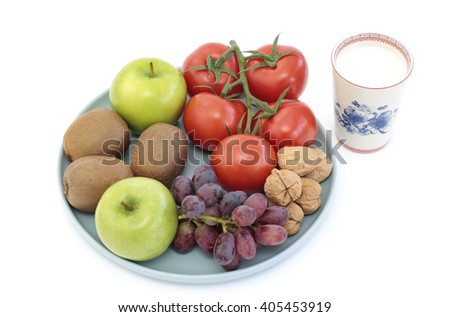 Variety of fruit, tomatoes, walnuts and a glass of milk  - stock photo