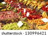 Variety of fruits and vegetables in boxes on the grocery market - stock photo
