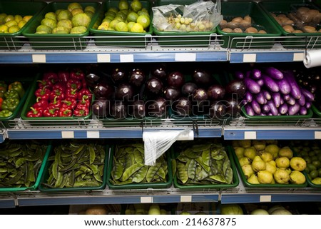 Variety of fruits and vegetables on display in grocery store - stock photo