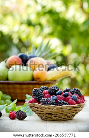 Variety of fruits for your health - antioxidants - stock photo