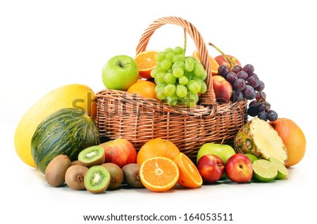 Variety of fruits in wicker basket isolated on white background